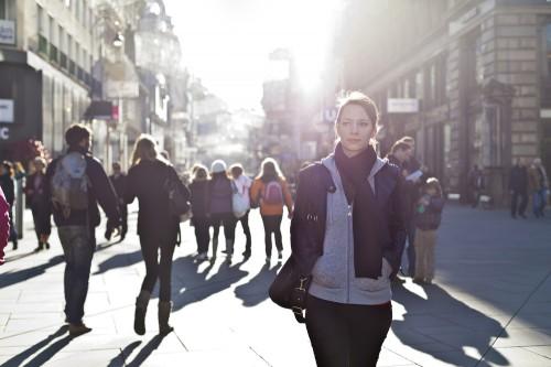 Girl walking on city street