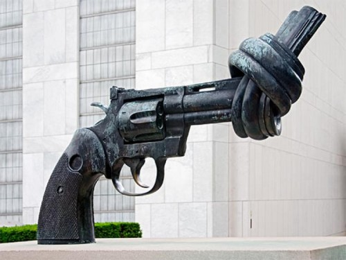 "The Knotted Gun sculpture, entitled ""Non Violence,"" outside the United Nations headquarters in New York City. In the context of the UN's repeated failures to stop war and violence, the irony of this sculpture approaches embarrassing."