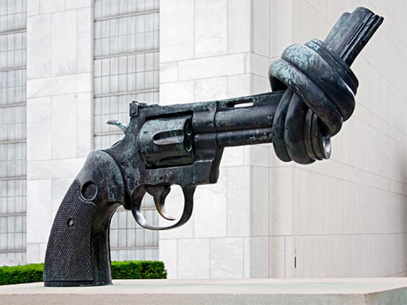 """The Knotted Gun sculpture, entitled """"Non Violence,"""" outside the United Nations headquarters in New York City. In the context of the UN's repeated failures to stop war and violence, the irony of this sculpture approaches embarrassing."""