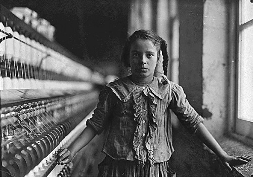 Young girl working in a factory during the industrial revolutioin