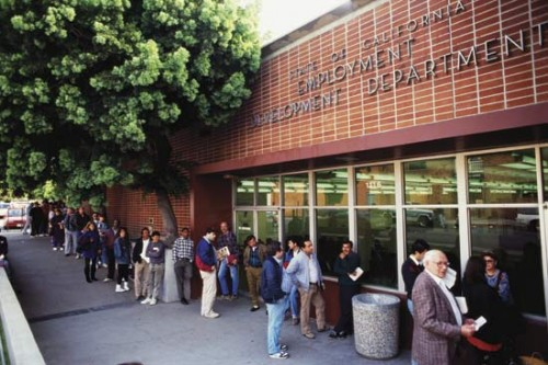 People in line at an Employment Development office in California, where unemployed people collect benefits.