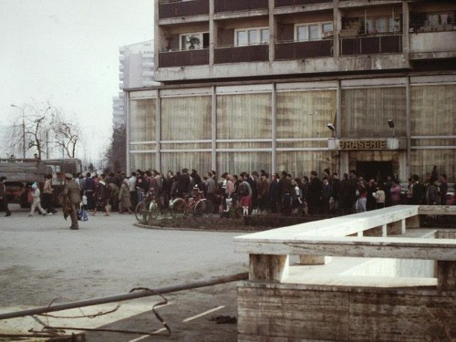 Choices were extremely limited in the communist countries of the Soviet Union. In the photo above, people wait in line to purchase cooking oil in Romania, Bucharest. Compare this with the photo below of Whole Foods, a natural foods market in America, where customers have a seemingly endless array of options.