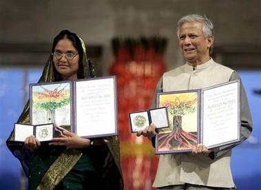 Muhammad Yunus and Mosammat Taslima Begum, representing Mr. Yunus's Grameen Bank