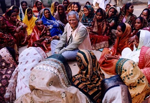 Muhammad Yunus visits Grameen Bank Centers and loan holders, who are mostly women. Copyright © Grameen Bank Audio Visual Unit, 2006