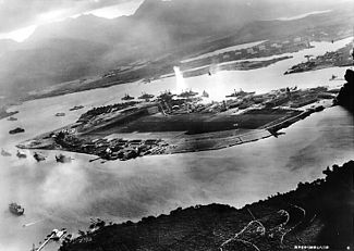 Photograph from a Japanese plane of Battleship Row at the beginning of attack. The explosion in the center is a torpedo strike on the USS Oklahoma.