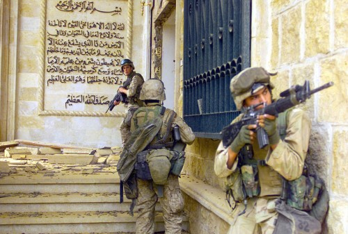 U.S. Marines enter a palace during the Fall of Baghdad, 2003.