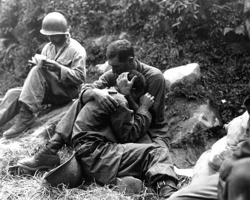 G.I. comforting a grieving infantryman, Korean War.