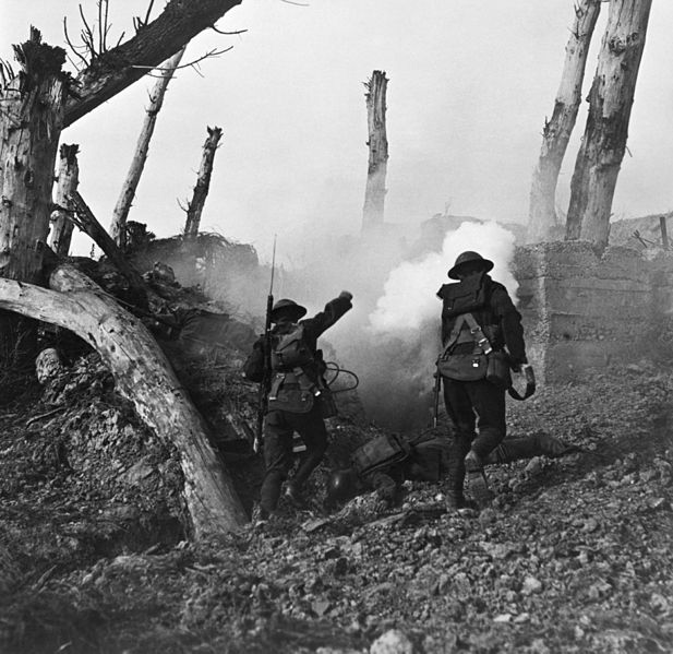 Two U.S soldiers run toward a bunker past the bodies of two German soldiers during World War I.