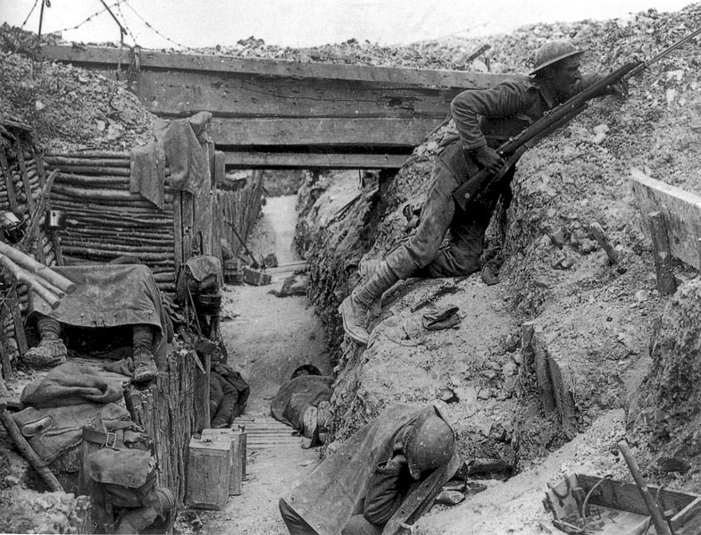 Trenches of the 11th Cheshire Regiment on the Somme, July 1916. One sentry keeps watch while the others sleep. Photo by Ernest Brooks.