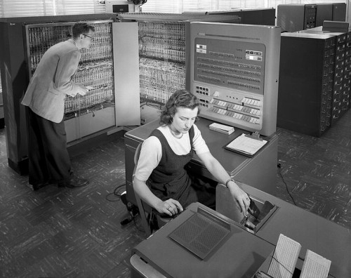 NACA researchers (later NASA) using an IBM type 704 electronic data processing machine in 1957.