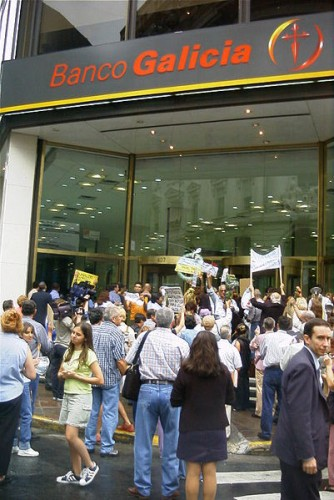 Depositors protesting frozen accounts for fear they might lose value, or worse. February 2002.
