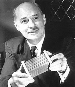 Eugene Houdry in 1953, holding a small catalytic converter.