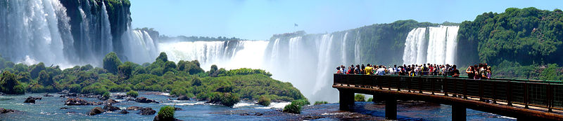Onlookers marvel at the dramatic Iguazu Falls on the border of Brazil and Argentina
