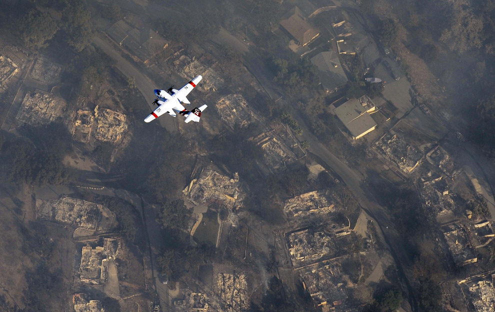 Damaged homes in Montecito, California (outside Santa Barbara). The single home not destroyed was spared due to the efforts of a private fire and insurance company.