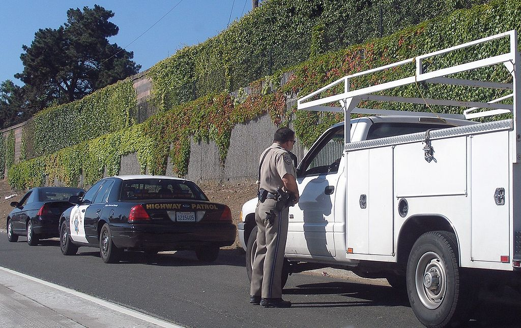 A California Highway Patrol pulling a driver over.