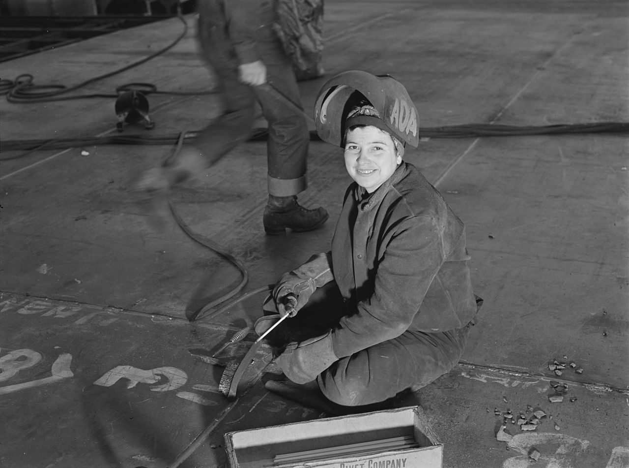 Lady welder in a California shipyard