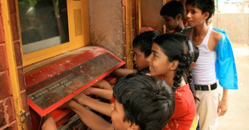 Children in New Delhi learning and playing on the computer