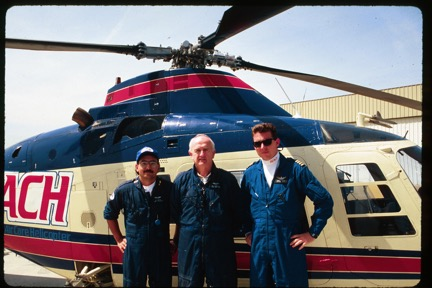 Dr. McDonald with REACH helicopter and two crew members